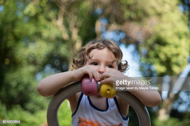boy at playground from below - autism awareness stock pictures, royalty-free photos & images