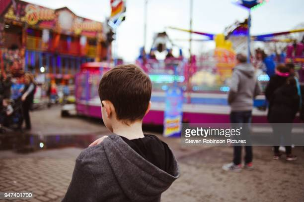 boy at the carnival - one boy only stock pictures, royalty-free photos & images
