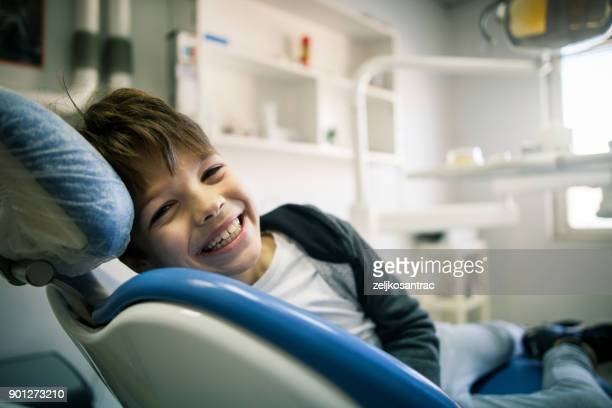 boy at the dental office - pediatric dentistry stock photos and pictures