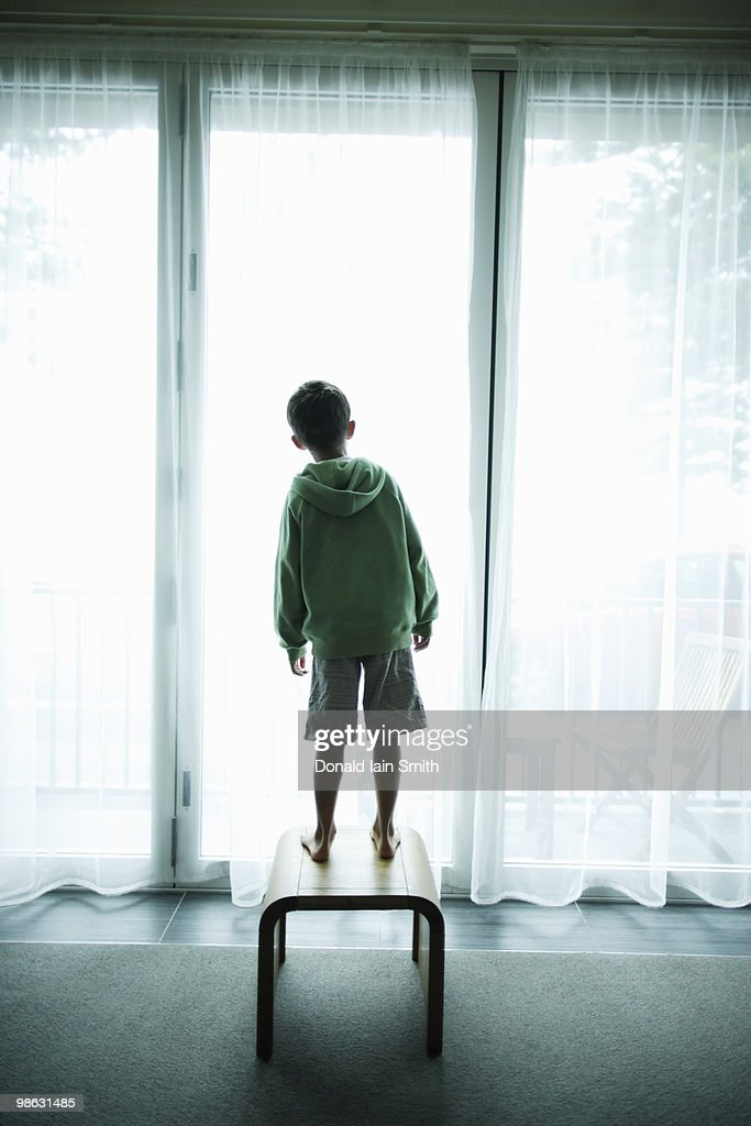 Boy at the window : Stock Photo