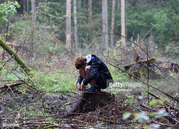 A boy attends a protest against the cutting of trees in the Bialowieza Forest in Stara Bialowieza Poland on August 13 2017 The European Commission...