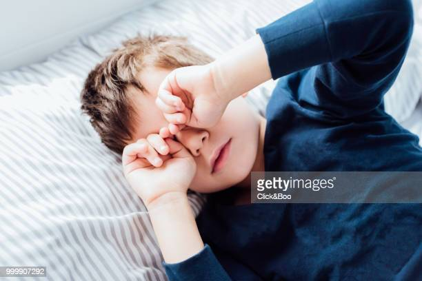 Boy awakening from a deep sleep