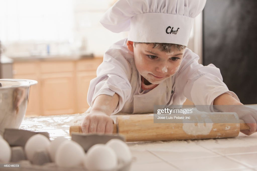Boy baking in chef's whites : Stock Photo