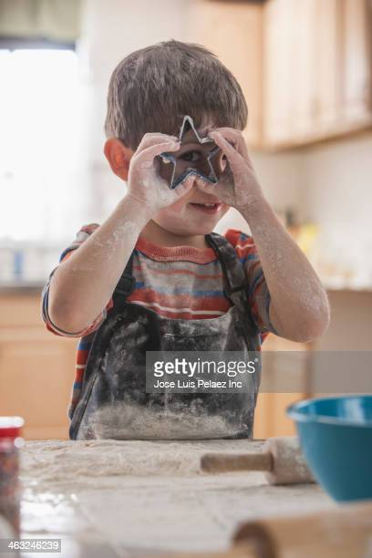 Boy baking in kitchen
