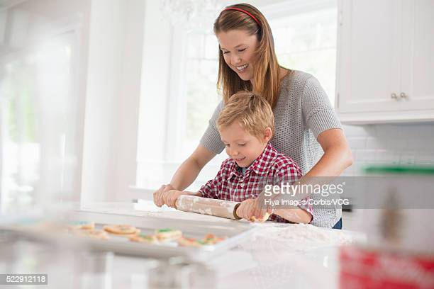 Boy (6-7) baking with his mother