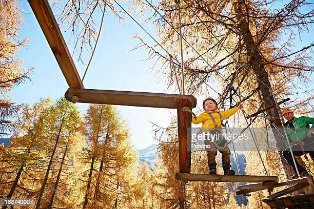 Boy balancing at a High Rope Course