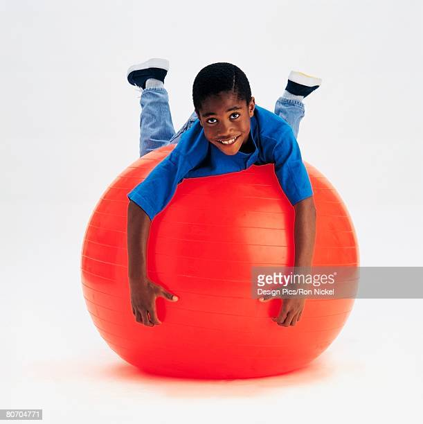 Boy balancing on exercise ball