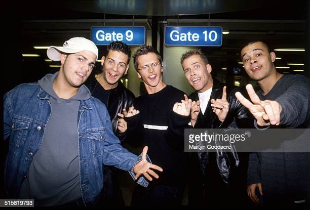 Boy band Five pose together at an airport in Sweden 2001 The band includes Jason Brown Abz Love Sean Conlon Ritchie Neville and Scott Robinson