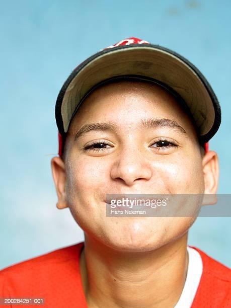 Boy (10-12) baseball player, portrait