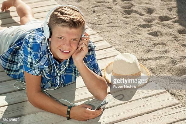 Boy beach summer headphones listening music