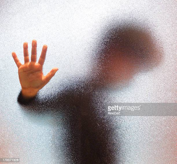 boy behind glass door - child abuse stock pictures, royalty-free photos & images