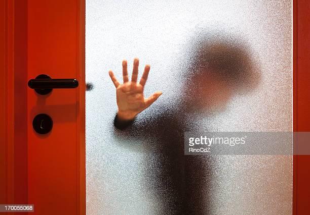 Boy Behind Orange Door
