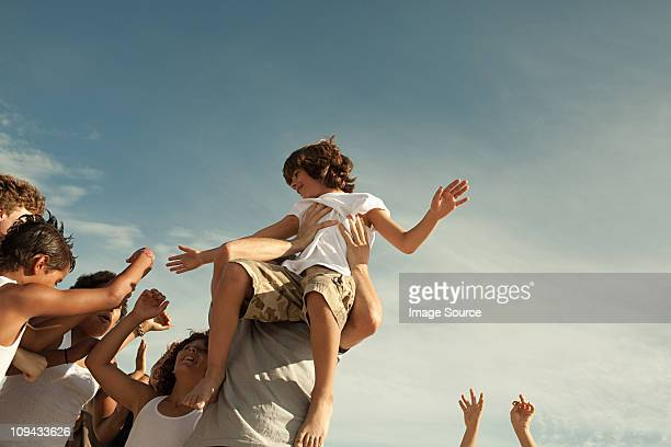 Boy being carried on shoulders