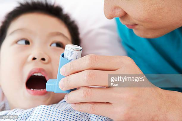Boy Being Handed Inhaler