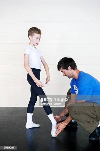 Boy being instructed in ballet