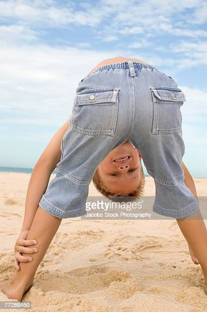boy bending over on beach - boys bare bum stock photos and pictures