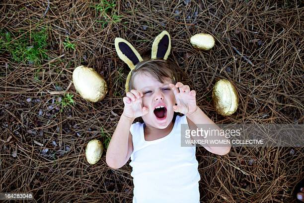 Boy  big roar with Easter Eggs and bunny ears