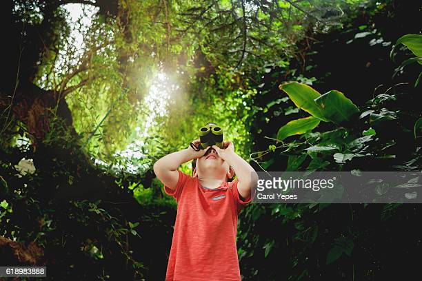 boy binoculars looking  outdoors