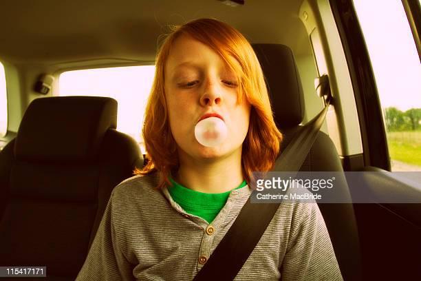 boy blowing bubble gum bubble - catherine macbride stock pictures, royalty-free photos & images