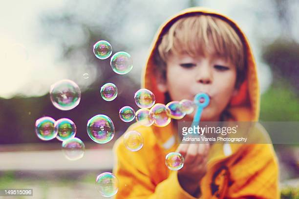 boy blowing bubbles - bubble stock pictures, royalty-free photos & images