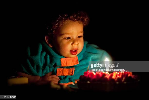 Boy blowing candle