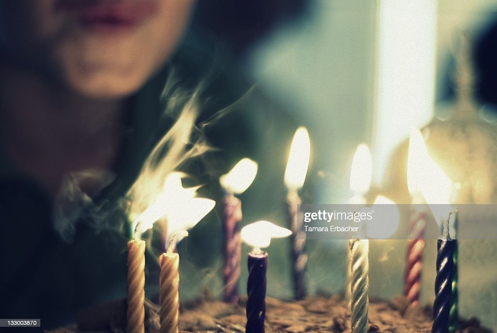 Boy blowing candles : Stock Photo