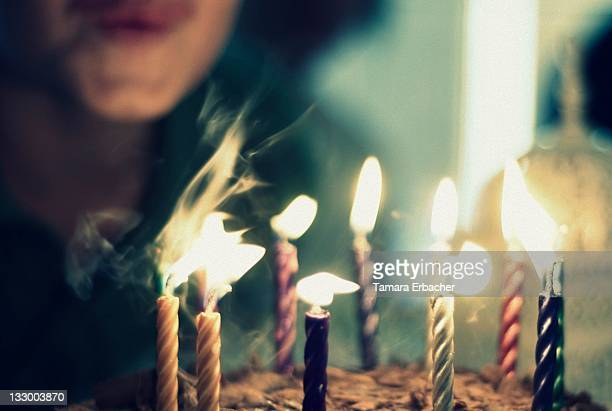 boy blowing candles - birthday cake stock photos and pictures