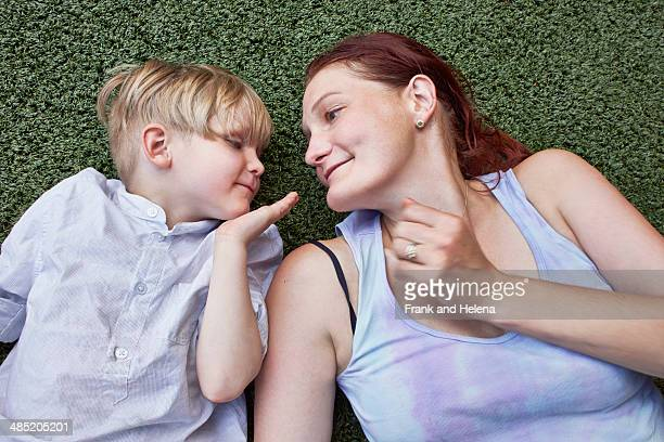 Boy blowing kiss to mother