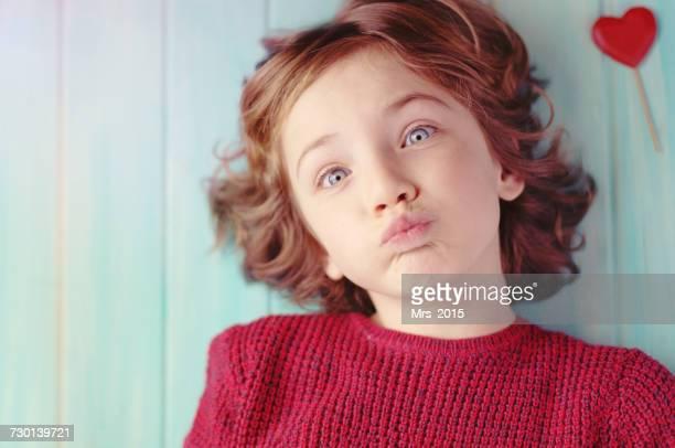 Boy blowing kisses