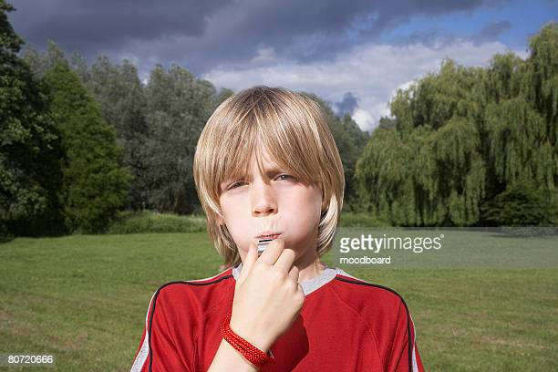 Boy Blowing Whistle