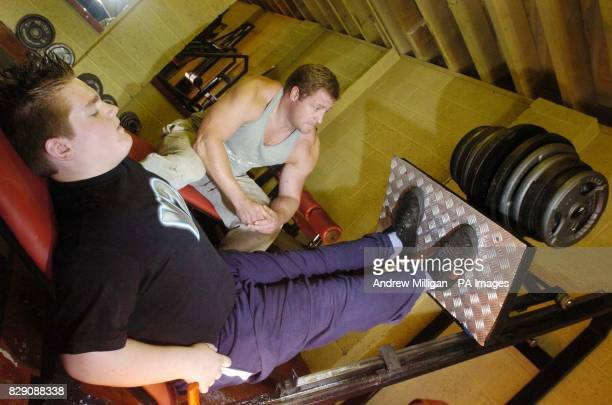 Boy bodybuilder Kevin Fortune, aged 12, in his neighbour, Jim Mackay's gym, Edinburgh. The 18-stone youngster is to start weight training in the hope...