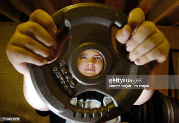 Boy bodybuilder Kevin Fortune, aged 12, in his neighbour's gym, Edinburgh. The 18-stone youngster is to start weight training in the hope of one day...