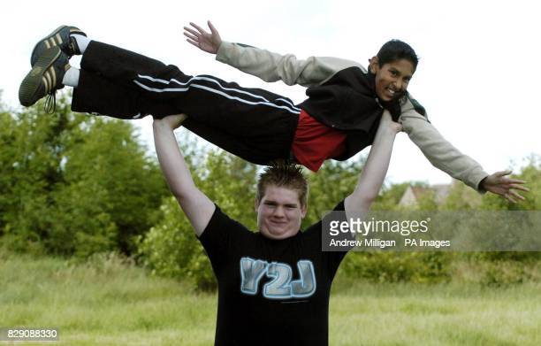 Boy bodybuilder Kevin Fortune, aged 12, lifting his friend Cameron Sharif, also aged 12, over his head, Edinburgh. The 18-stone youngster is to start...