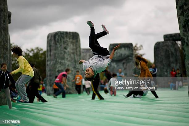 A boy bounces on Sacrilege an inflatable sculpture of Stonehenge created by British artist Jeremy Deller at Parque del Soto on April 25 2015 in...