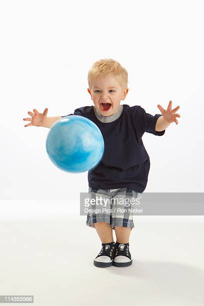 a boy bouncing a ball - blue balls pics stock pictures, royalty-free photos & images