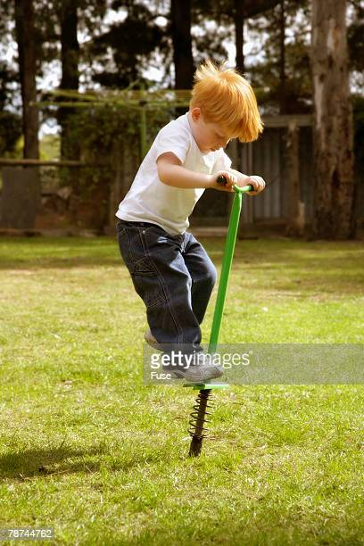 Boy Bouncing on Pogo Stick