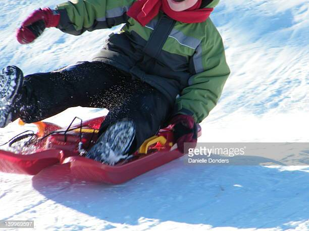 Boy bouncing out of sled