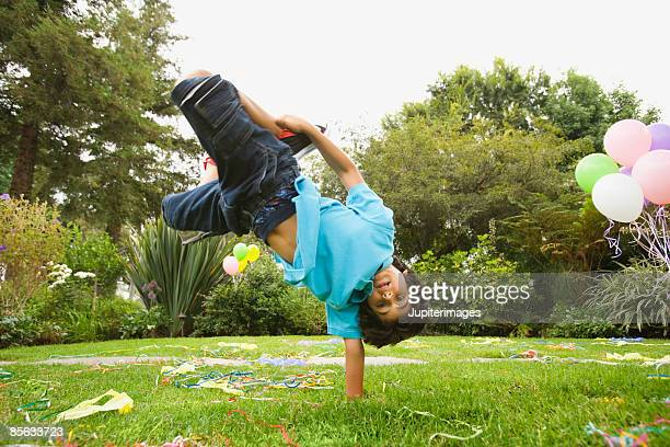 Boy breakdancing at birthday party