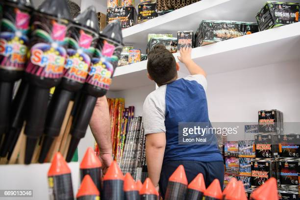 A boy browses some of the fireworks and rockets available on the day before the annual Rocket War known locally as the 'Rouketopolemos' on April 14...