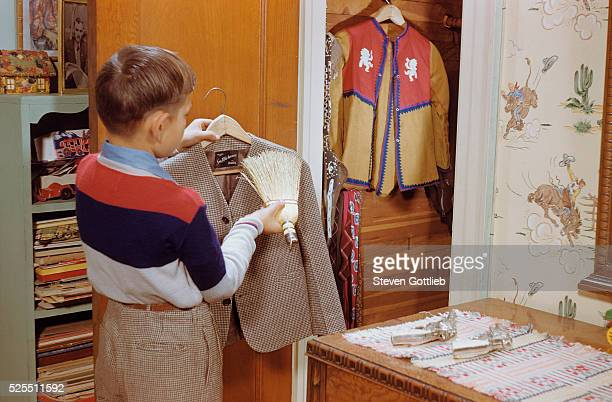 Boy Brushing His Suit Jacket