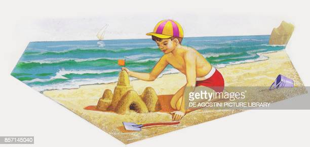 Boy building a sand castle at the seaside drawing