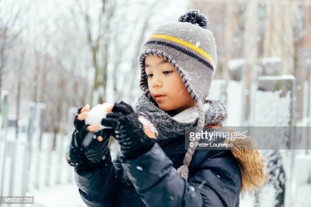 Boy building a snowman