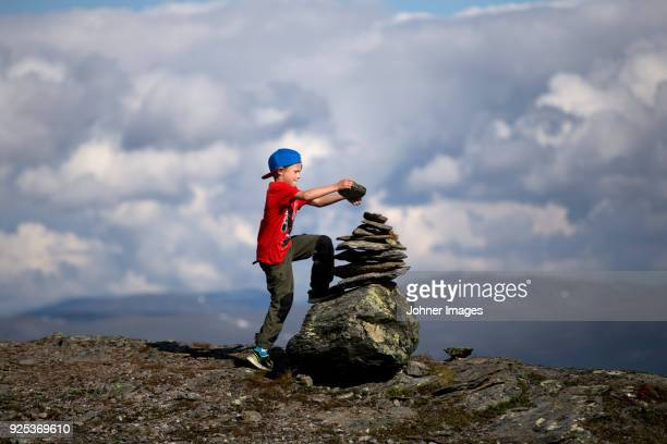 Boy building cairn