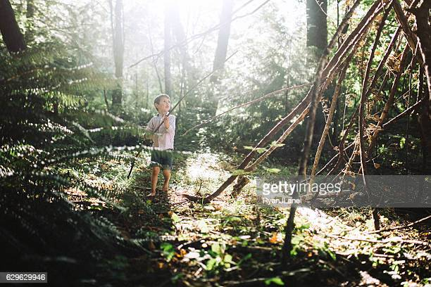 Boy Building Forest Fort