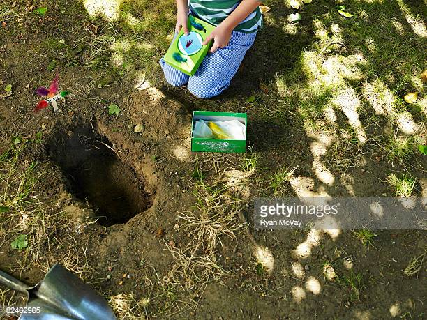 boy burying dead bird - losing virginity stock pictures, royalty-free photos & images
