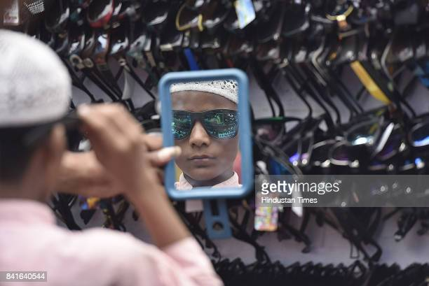 A boy buying sun glass during the Eid festival at Jama Masjid on September 1 2017 in New Delhi India Muslims across the world are preparing to...