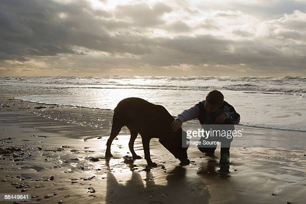 Boy by sea with dog