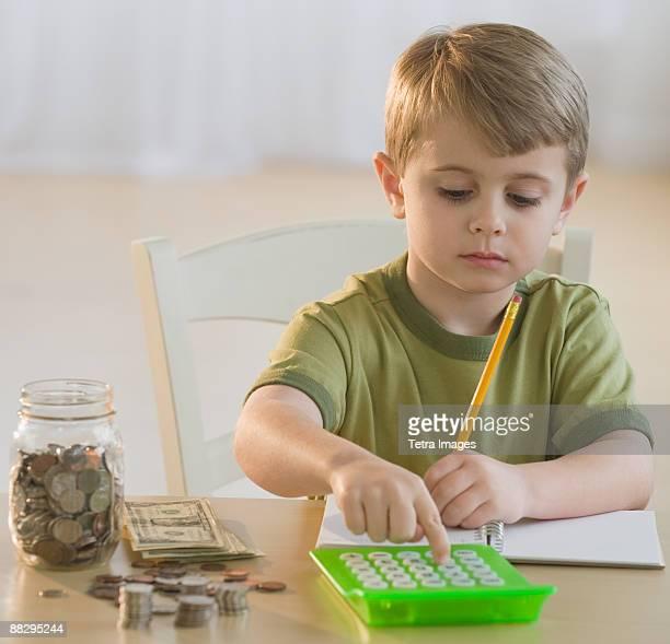 Boy calculating personal finances