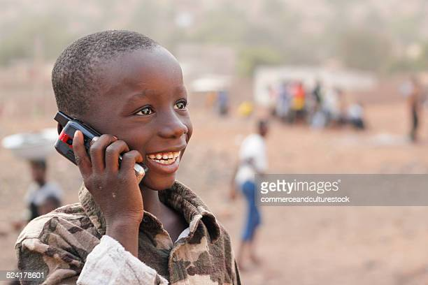 A boy calling with a mobile phone