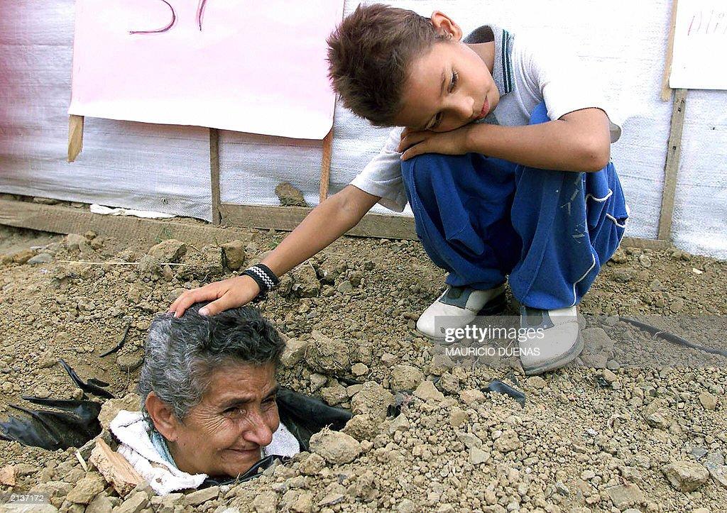 A boy caresses his grandmother's head, o : News Photo